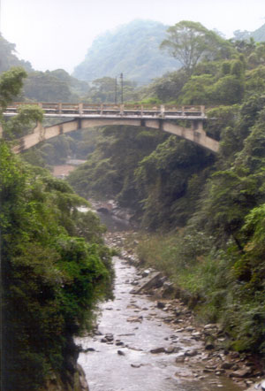 The old arched  Baan bridge in Sanhsia, which means Three Gorges.