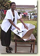Woman cooking food on a Solar Cooker